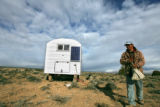 (DLM8317) -  Sheepherder Lucho Hurtado Aylas, 38, heads out to his flock from the camper where he...