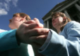 (L-R) Terra Summers (cq) a CNA, holds Holly Fiscus' hand   during a rally Monday February 26, 2007...