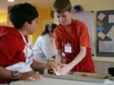[JOE116]  Cooking students Miles Chow (cq), left,  9,  of Boulder (in red hoodie), and Drew Pasma,...