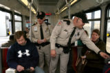 Security guards Danny Kenney, (cq), left, and Vince Iovinella (cq) check passengers for valid...