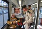 Student Jacob Clark, (cq), left, is asked for his LightRail ticket by security guard Danny Kenney,...