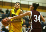 Regis University's Diana Lopez (#31) drives to the basket against Chadron State's Sunni Busch...