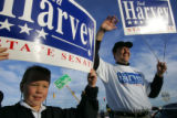 (Timeshot: 07: 38) Jack Harvey, 9, son of Colorado state Representative Ted Harvey, right, holds a...