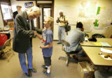 11:27 A.M. Theo Reitwiesner (CQ), 10, right, of Colorado Springs shakes hands with Bill Ritter,...