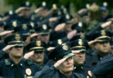 (Denver, Colo., May 13, 2004) Aurora Police Department chaplain Lynn Parker, center, salutes...