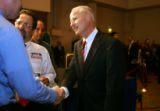 Republican Secretary of State candidate Mike Coffman shakes hands with a supporter at the...