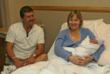 Andrew Mihlstin (cq) left, and his wife Joanne, holding their new baby girl Hannah Brittany...