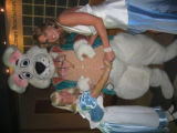"From left, ""Alice"" and the White Rabbit greet Booklovers' Ball co-chairwoman Kristina..."