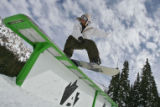 DLM05177   A snowboarder slides down one of the rails in the Banana Terrain Park at the Arapahoe...