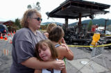 (FRISCO, Colo., Aug 5, 2004)  Laurie Williams of Lakewood, hugs her two daughters Kristy,9 and...