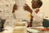 MJM658  Denver Election Commission employee, Patricia Nelson (cq) processes absentee ballots by...