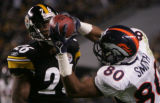 (JPM737)  In the second quarter, Denver Broncos Rod Smith, right, grabs the ball against...
