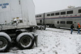 An Amtrak trains sits still on the tracks after hitting a semi-truck, Thursday Oct. 26, 2006, at...