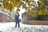 DLM00023   Dave Lopez, 61, knocks the heavy snow from the tree in his front yard in hopes of...