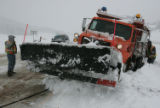 CDOT workers, (no names) work to free two snow plows stuck on east bound HWY 285 in Aspen Park...