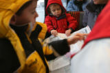 Ian Brown, 6,  (cq, left in yellow), Adam,4, tries to fold his train map all by himself,...