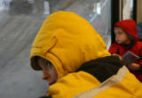 Ian Brown,6, (cq), left, yellow, watches the world go by from his train window with his brother,...