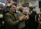 Ed Perlmutter, candidate for CD 7 applauds other candidates at the Democratic headquarters with...