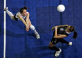 Longmont Christian Warriors Amber Jackson, left, narrowly misses teammate Hannah...