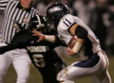 [JPM143] Columbine Rebels junior runningback Chad Korodaj, #11, stiff arms Pomona Panthers senior...