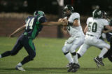 (DLM2089) -  ThunderRidge defensive end James Breidel, #44, gets a hand on Pinecreek High School...