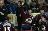Colorado Avalanche Joe Sakic wave to the crowd after he scored his 1,500th career point with an...