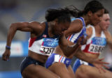 (ATHENS, GREECE-AUGUST 20, 2004)  United States' Gail Deavers, left, races against France's...