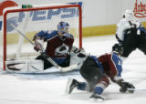 Colorado Avalanche goalie Peter Budaj does the splits at Washington Capitals #52 Mike Green scores...