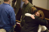 Shannon Cupp  (r), a member of Cherry Creek Community Church in Denver, mourns the death of...
