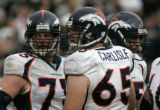 (BG0908} Denver Broncos #75 Adam Meadows looks back at the Rader defense with teammate Cooper...