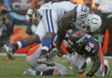 (050) Indianapolis Colts running back Joseph Addai, top, gets up ended by Denver Broncos...