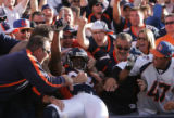 (JPM351) Denver Broncos Javon Walker celebrates by leaping into the first row of fans after his...