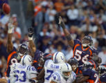 (MAP769)The Denver Broncos Al Wilson (#56, LB) and teammates try to block a field goal by the the...
