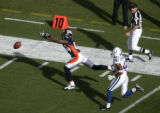 (BG223) Denver Broncos Javon Walker can't pull in a pass from Jake Plummer with Indianapolis Colts...