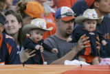 (BG736) Denver Broncos fans Ginger Shannon, left, and Jake Shannon, right, hold their twin...
