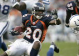 (BG817) Denver Broncos Mile Bell runs through the line against Indianapolis Colts in the third...