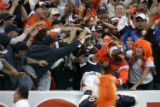 (BG548) Denver Broncos Mike Bell jumps into the stands after scoring in the fourth quarter against...