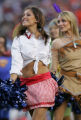 (JPM1340) Denver Broncos cheerleaders don Halloween costumes as they perform between the third and...