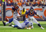 (MAP074)The Denver Broncos Ian Gold (#52, LB) closes in on the Indianapolis Colts Dallas Clark...