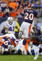 (MAP674)The Denver Broncos Mike Bell (#20, RB) goes up and over the pile against the Indianapolis...