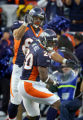 (MAP704)The Denver Broncos Chad Mustard (#85, TE) celebrates with teammate Mike Bell (#20, RB)...