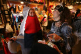 (DLM0016) -  Mollie Randolf, 21, from left, laughs as costume consultant Manda Pendleton helps her...