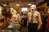 Brent Warkentine of Erie, wears a mask to show his wife Dawn while they shopped for costumes at...