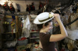 Bridget O'Brien (cq), from Denver, tries on a hat that she says will transform her into a Southern...