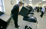 (BG072) Denver Mayor John Hickenlooper votes at the Monclair Recreation Center early voting...
