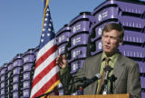 DLM00239   Denver Mayor John Hickenlooper stands in front of a mountainous stack of the city's new...
