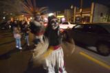 Elizabeth Romero leads a parade of people with her traditional Aztecan Dancers Groupo Tlaco down...