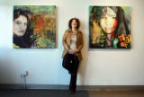 Denver artist Julie Puma (cq), 40, photographed next to some of her work that opens with a show...