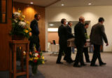 MJM118  Frank Bingham, left, walks out behind the coffin of his son, Garrison Bingham after a...