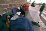 Shawn Brower (cq), 20, wakes up early Thursday morning November 16,2006 in front of Best Buy at...